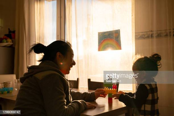 mother and daughter playing with toy blocks - sunbeam stock pictures, royalty-free photos & images