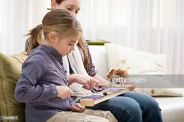 Mother and daughter playing xylophone