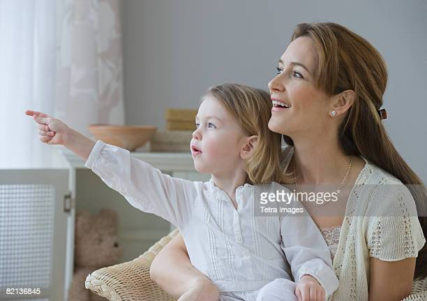 Mother and daughter pointing and looking