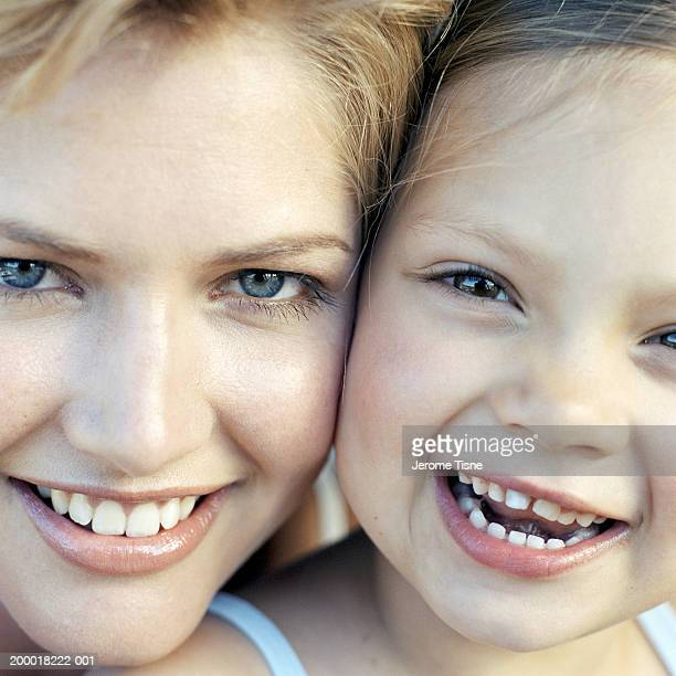 Mother and daughter (4-6), portrait, close-up