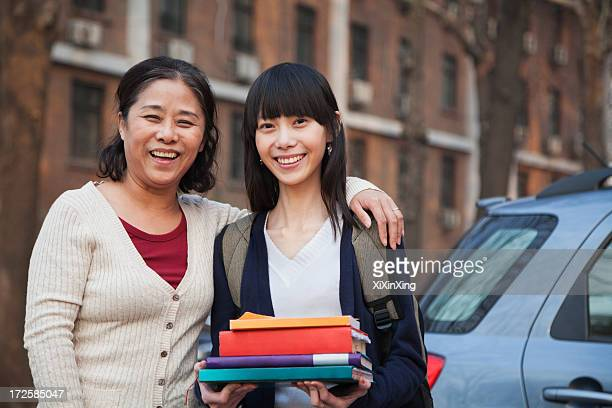 Mother and daughter portrait in front of dormitory