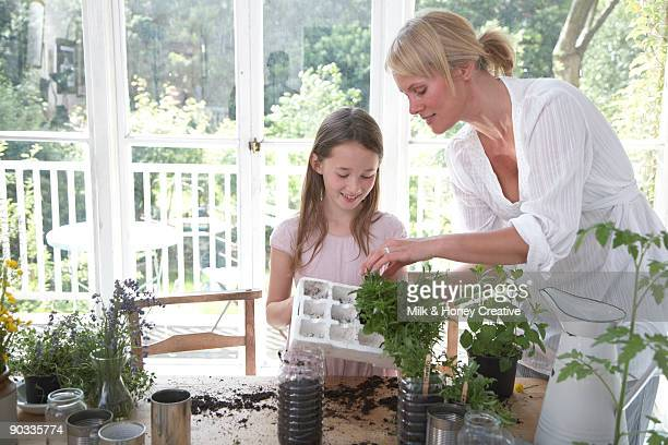 Mother and daughter potting plants