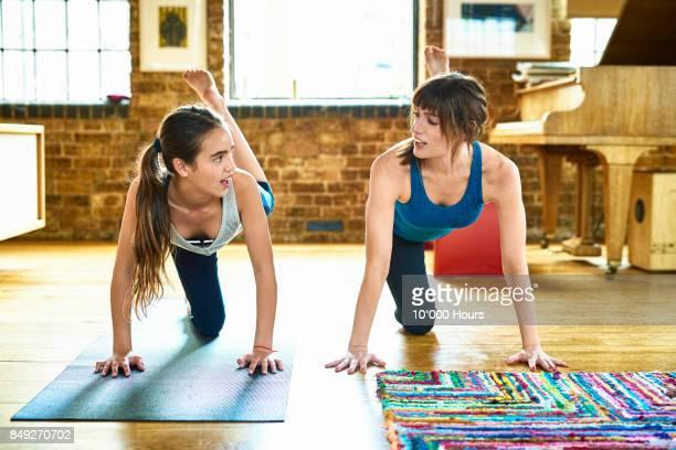 mother and daughter practicing yoga - 10 11 anni foto e immagini stock