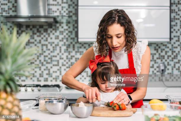 Mother and Daughter Preparing Breakfast Together