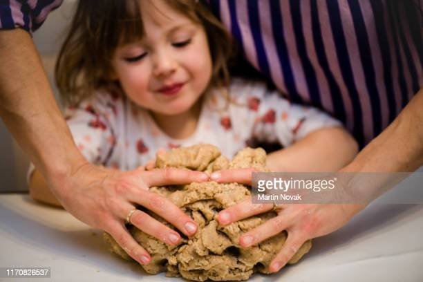 mother and daughter preparing dough in kitchen - thick girls stock photos and pictures