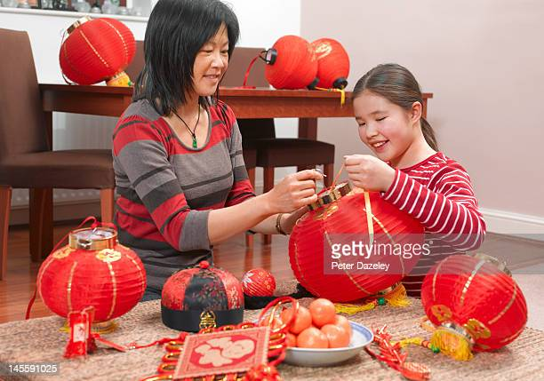 Mother and daughter preparing for Chinese New Year