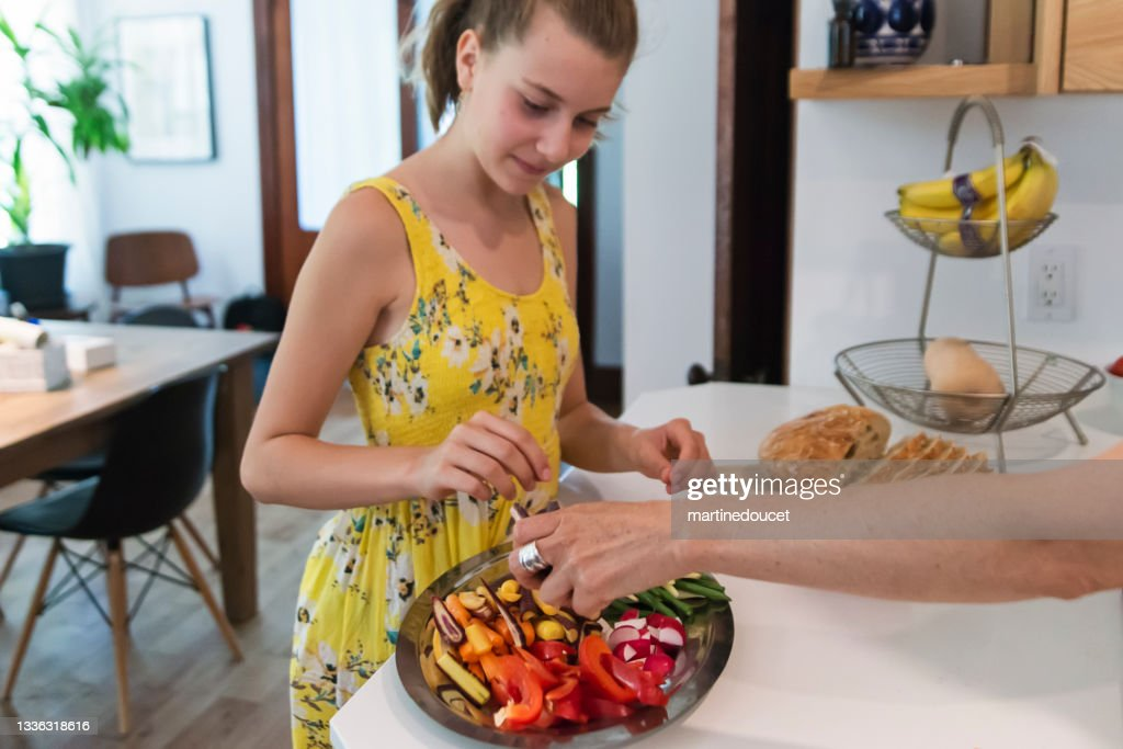 Mother and daughter preparing lunch in home kitchen. : Stock Photo
