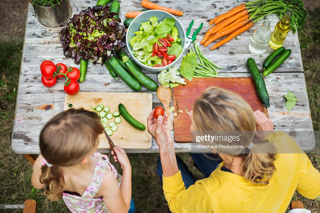 Mother And Daughter Preparing Salad : Stock Photo