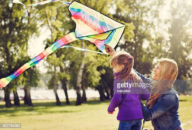 Mother and daughter preparing the kite to fly