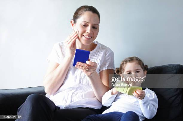 Mother and Daughter Putting Makeup Together