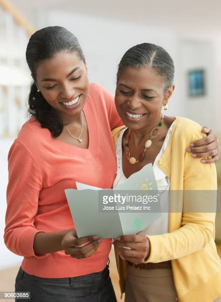 Mother and daughter reading card