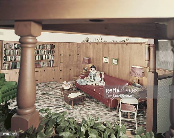 mother and daughter reading magazine in living room - 1955 stock pictures, royalty-free photos & images
