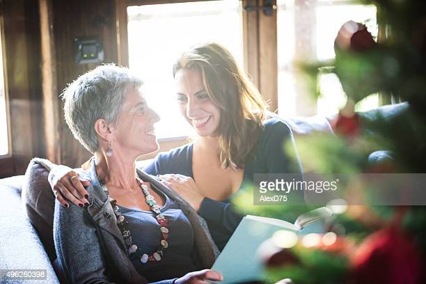 Mother and Daughter Reading on Sofa