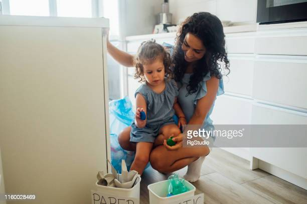 mother and daughter recycling - selfless stock pictures, royalty-free photos & images