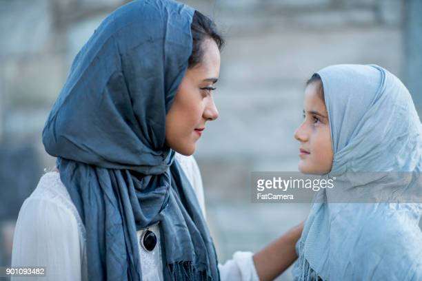 Mother And Daughter Refugees