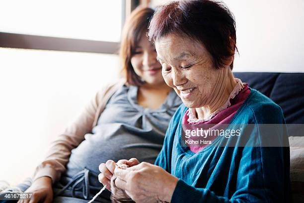mother and daughter relaxed at home - 多世代家族 ストックフォトと画像
