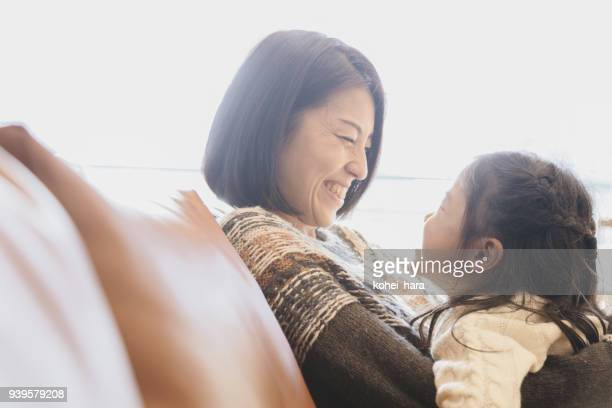 mother and daughter relaxed at home - japanese mom stock photos and pictures