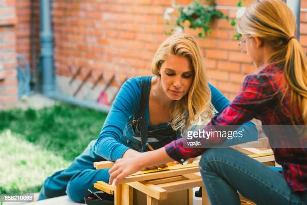 Mother And Daughter repairing furniture