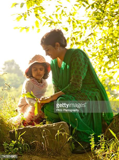 mother and daughter resting - salwar kameez stock pictures, royalty-free photos & images