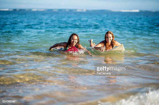 Mother and daughter returns from surfing the break