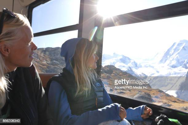 mother and daughter ride on train to highest station, mountains - switzerland stock pictures, royalty-free photos & images