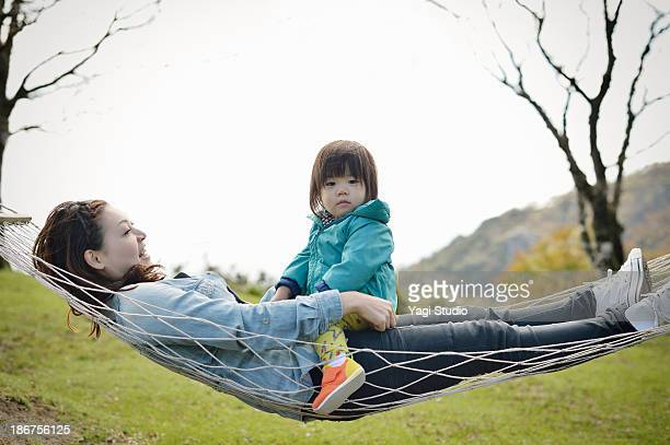 Mother and daughter riding a hammock