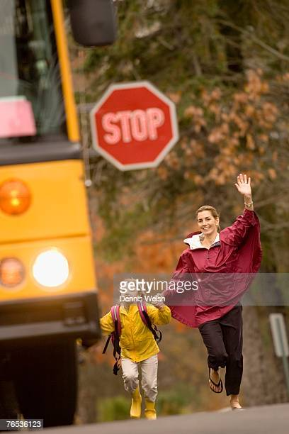 Mother and daughter running for school bus