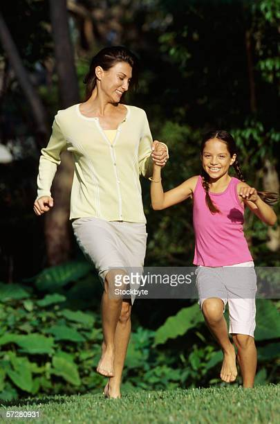 Mother and daughter running in the park