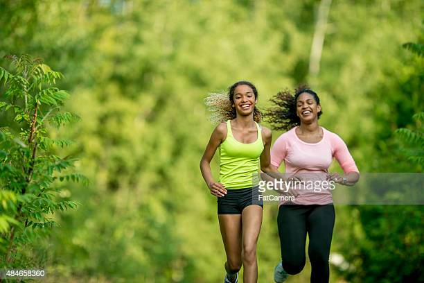 Mother and Daughter Running Together