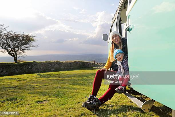 mother and daughter sat in camper on moors - innocence stock pictures, royalty-free photos & images