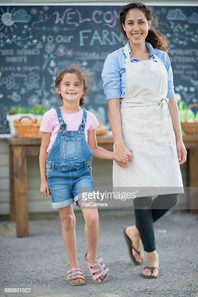 Mother and Daughter Selling Food From the Farm