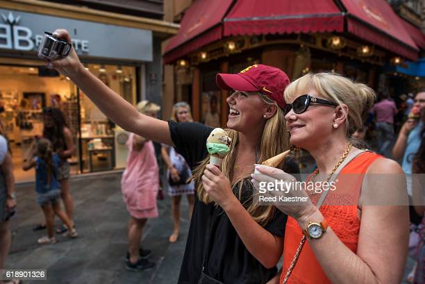 A mother and daughter share ice cream while taking a 'selfie'