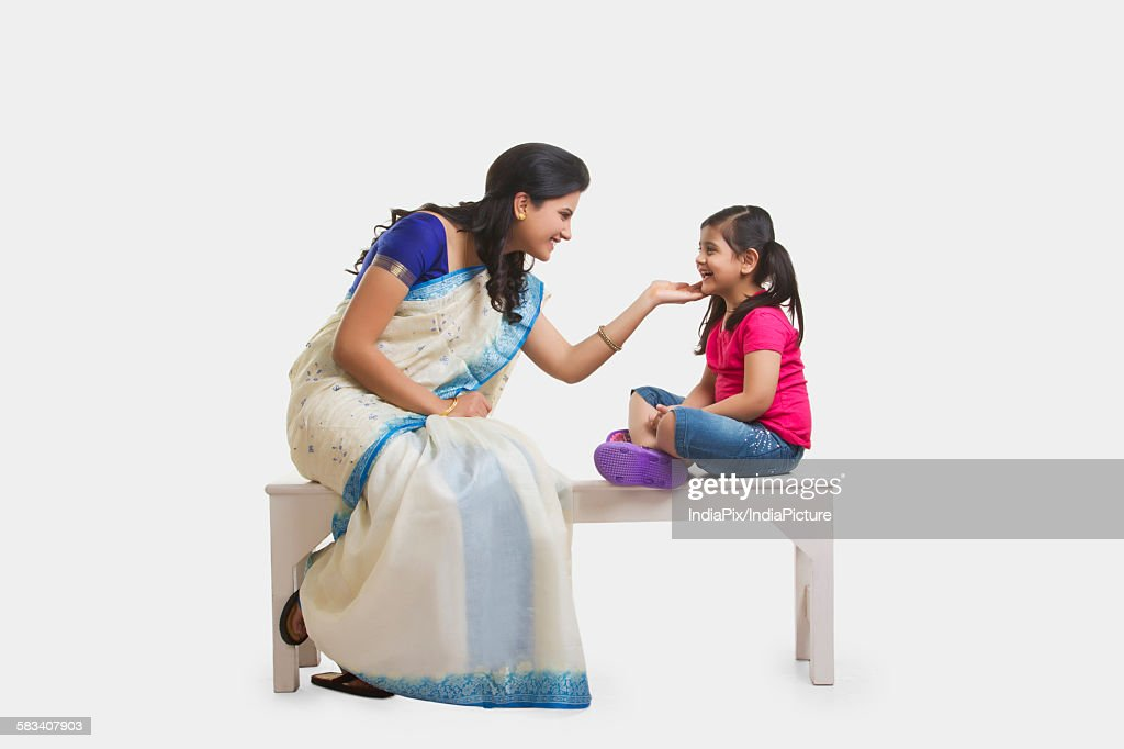 Mother and daughter sharing a moment : Stock Photo