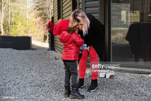 """mother and daughter sharing a secret outdoors in autumn. - """"martine doucet"""" or martinedoucet stock pictures, royalty-free photos & images"""