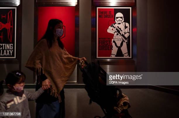 Mother and daughter shopping Disney's Star Wars merchandise at Disneyland Resort park official store in Hong Kong.