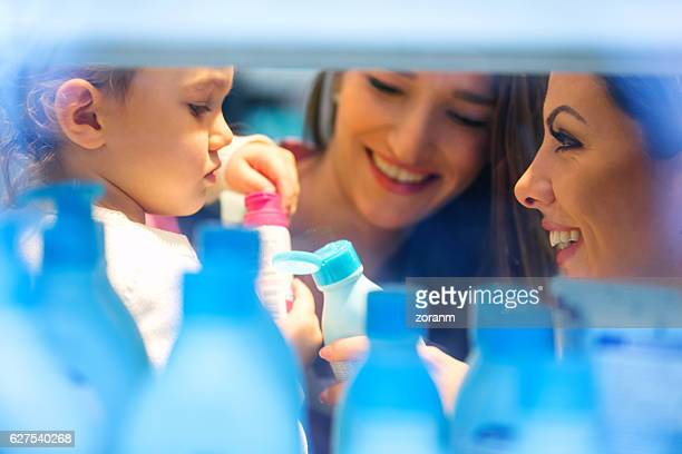 mother and daughter shopping for beauty product - toiletries stock pictures, royalty-free photos & images