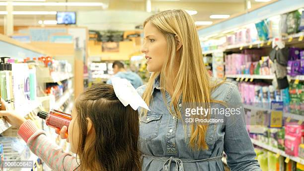 Mother and daughter shopping for beauty products in local store