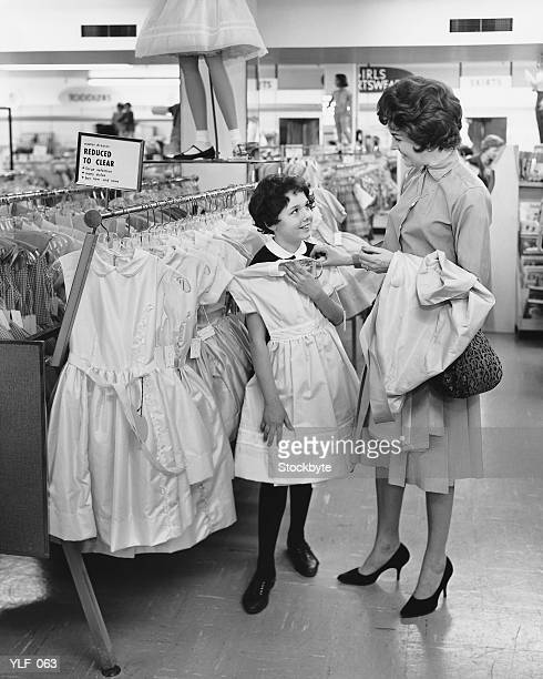 mother and daughter shopping for clothes - 20th century stock pictures, royalty-free photos & images