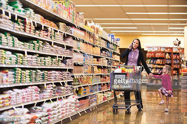 Mother and daughter shopping in grocery store