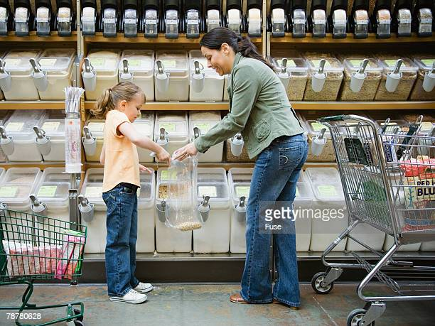 Mother and Daughter Shopping in Health Food Store