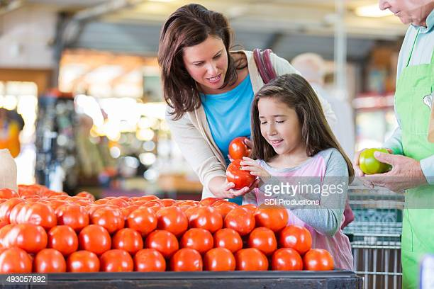 Mother and daughter shopping in local grocery store
