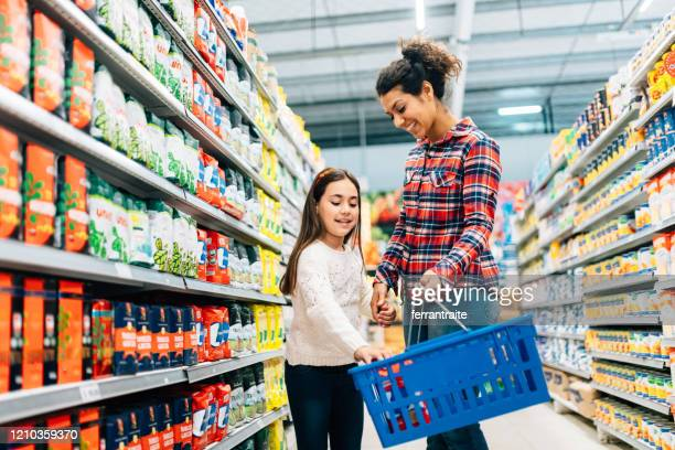 mother and daughter shopping in supermarket - groceries stock pictures, royalty-free photos & images