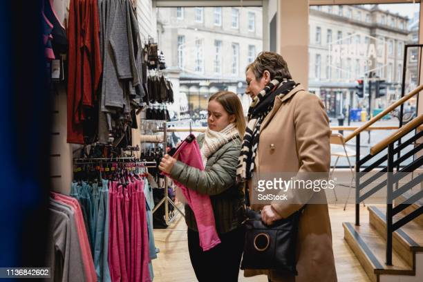 mother and daughter shopping - disability collection stock pictures, royalty-free photos & images