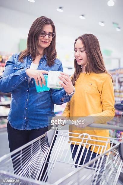 Mother and daughter shopping sanitary pad