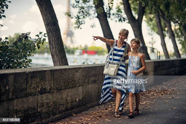 mother and daughter sightseeing paris, france - imgorthand stock photos and pictures