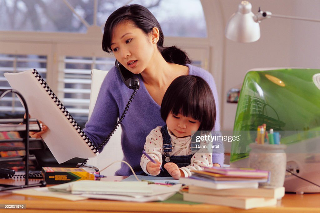 Mother and Daughter Sitting at Computer : Stock Photo