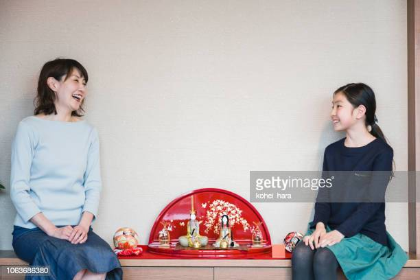 mother and daughter sitting by hina doll - hinamatsuri stock pictures, royalty-free photos & images
