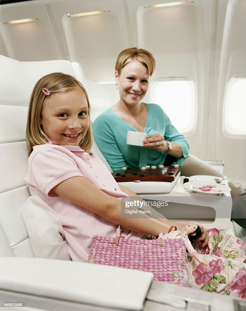 Mother and Daughter Sitting in an Aircraft Cabin : Stock Photo
