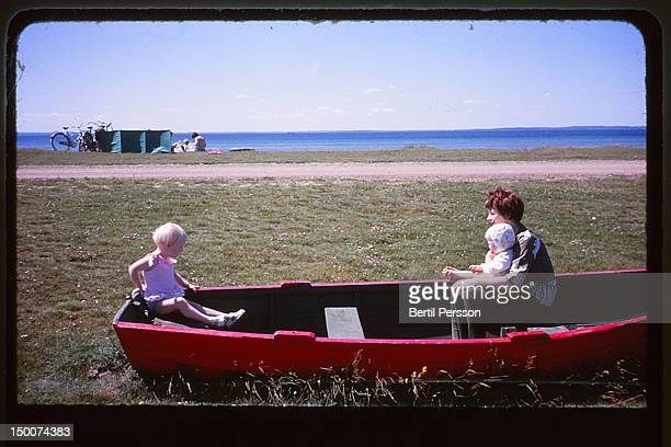 Mother and daughter sitting in rowing boat