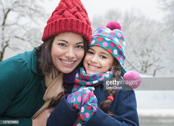 Mother and daughter smiling in the winter
